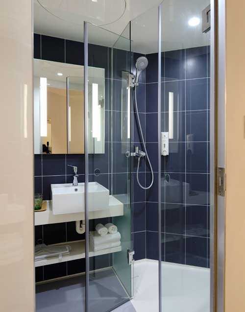 Install a floor-to-ceiling glass shower cabin